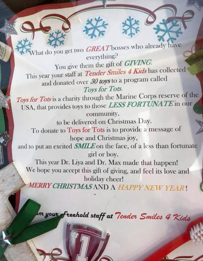 Toys for Tots sign at Tender Smiles 4 Kids office
