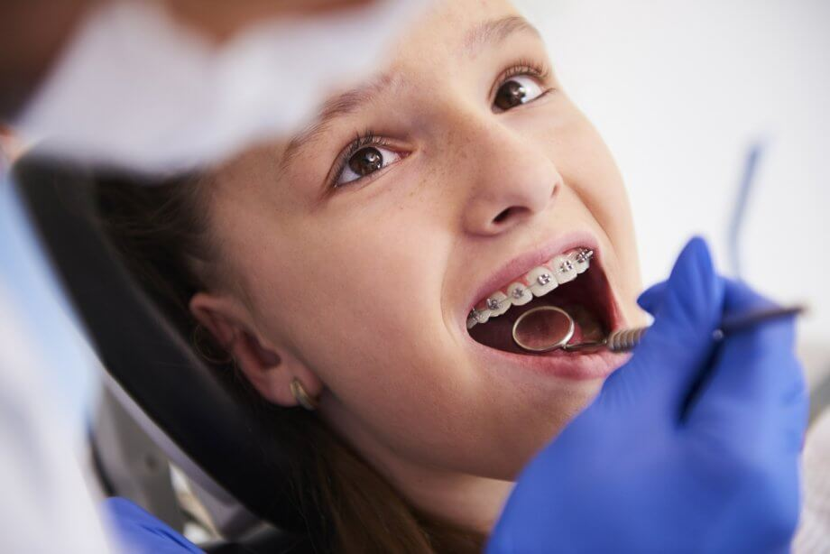 girl with braces at appointment