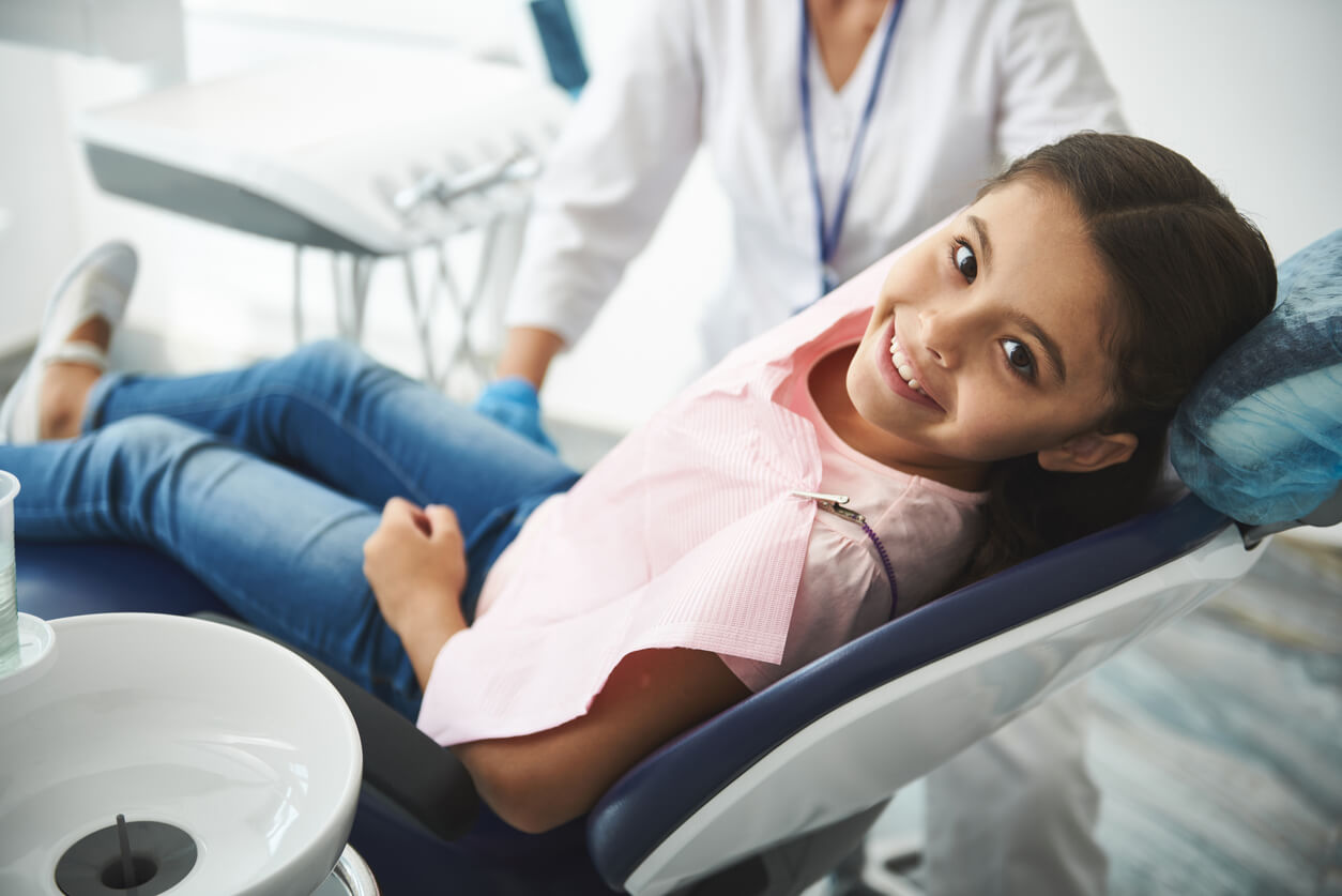 Young Girl In Dentist Chair Waiting For Icon Procedure
